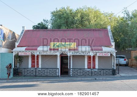 CALITZDORP SOUTH AFRICA - MARCH 25 2017: A homeless man at a restaurant in Calitzdorp a small town in the Western Cape Province