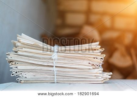 Greater Pack Of Newspapers On A Table With A Rope
