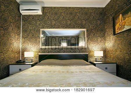 Podolsk, Russia - April, 14. 2017: Interior of a bedroom in a hotel with a picture on a wall in Podolsk, Russia