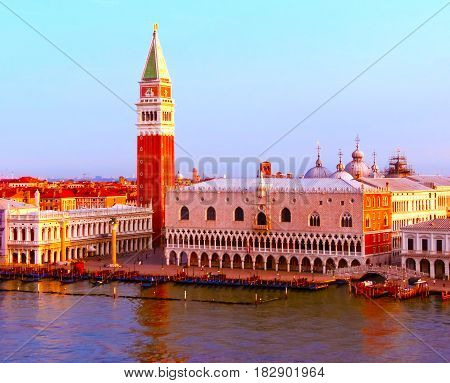 Beautiful view from Grand Canal on colorful facades of old medieval houses in Venice, Italy at sunset. Image blurred in postproduction