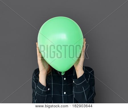 Woman close up holding balloon and posing for photoshoot