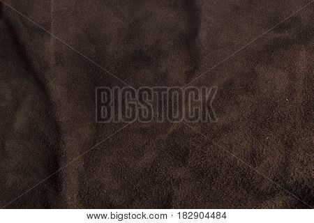 wrinkled Italian brown chamois leather texture background.