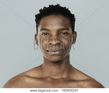 African man bare chest studio portrait
