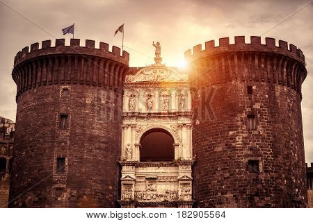 The New Castle at sunset Naples, Italy. The royal New Castle or Castel Nuovo is a residence of the medieval kings of Naples.