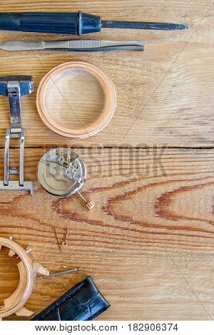 Special tools for repairing the clock on a wooden background.