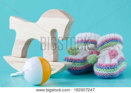 wooden toys isolated on aquamarine ифслпкщгтв with baby shoes