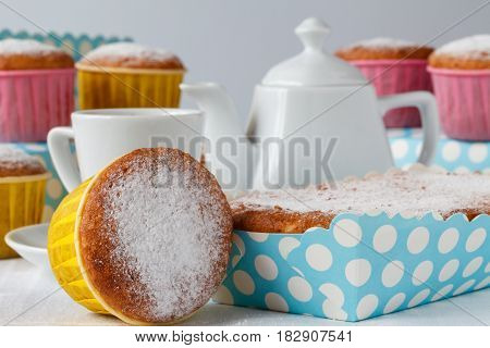 Tea party Sweet muffins and tea on table.