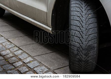 Car Tire Turned Sidewalk Parked Black White Asphalt Road Dirty Used