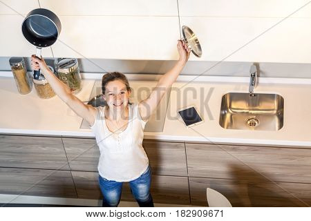 Happy smiley housewife woman with kitchen pan in morning. top view.