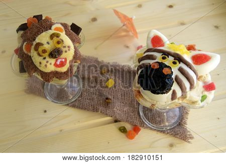 The zebra and lion are made of ice cream. A creative dessert for children and good mood.