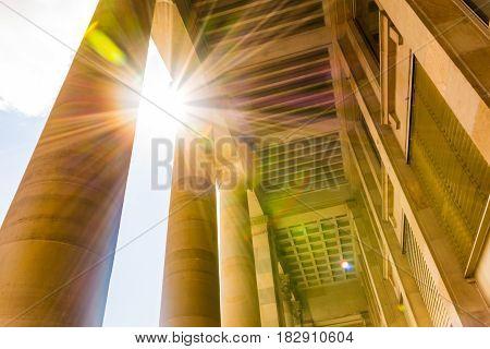 Sun Flare Through European Roman Columns Historic Brown Bright