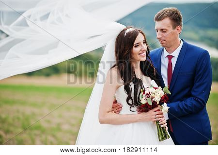 Wedding Couple In Love Stay At Beautiful Landscape With River On Background.