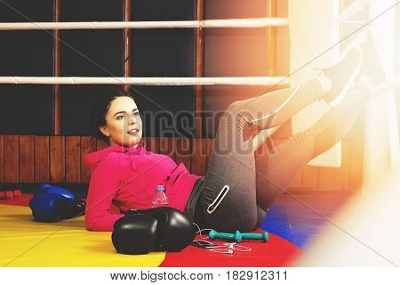 Beautiful Thirsty Boxing Girl Posing In The Ring And Drinking Water. Training At The Gym. Sporty Fem