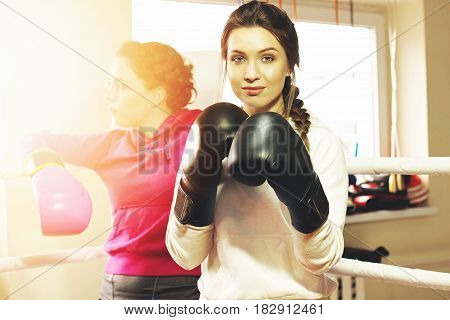 Portrait Of Beautiful Boxing Girl Posing With Black Boxing Gloves. Training At The Gym. Sporty Femal