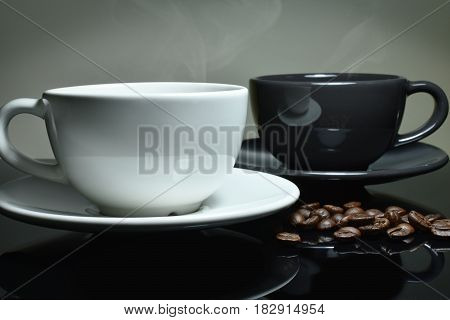 White and black Coffee cup coffee beans on black table Focus white cup.