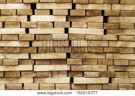 Wood timber construction material background and texture. Stack of lumberNatural wooden background.