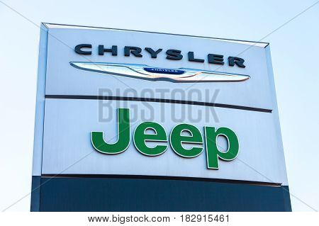 Samara Russia - February 13 2016: Chrysler Jeep automobile dealership sign against the blue sky. All are part of the Chrysler Motor Company an American automobile manufacture