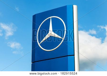 Samara Russia - May 22 2016: Official dealership sign of Mercedes-Benz against the blue sky. Mercedes-Benz is a German automotive manufacturer