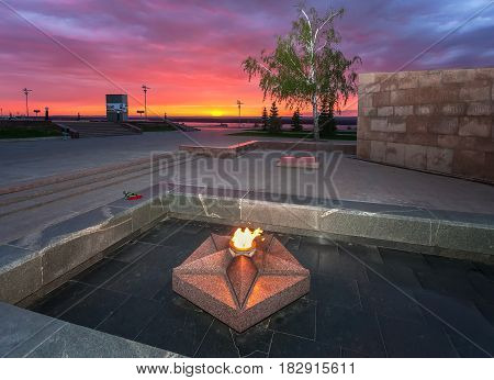 Samara Russia - may 6 2013: The eternal flame in the memorial complex on the sunset in Samara Russia