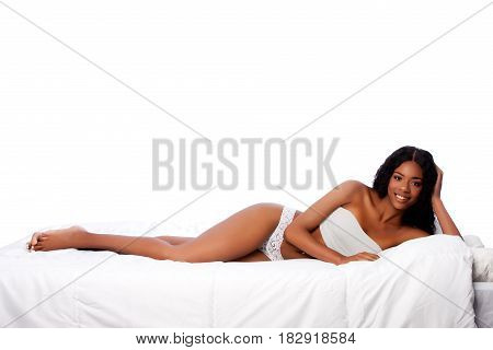 Beautiful Happy Woman Laying On White Bed