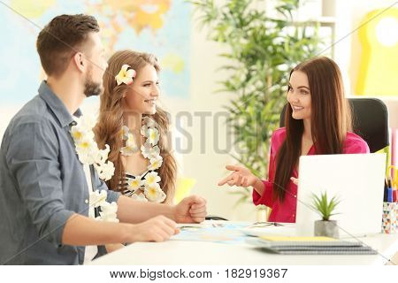 Adventure concept. Young couple visiting travel agency