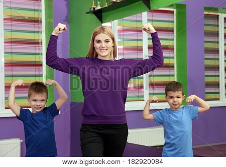 Dance teacher and boys posing in choreography class