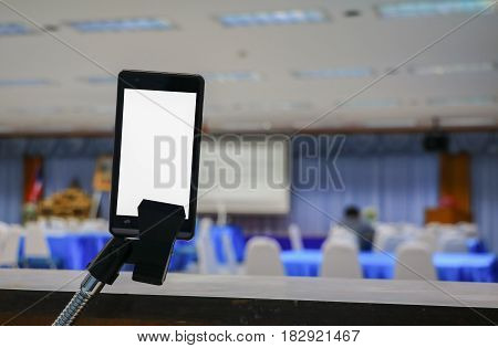 smartphone take on white screen of the meeting room business select focus with shallow depth of field.