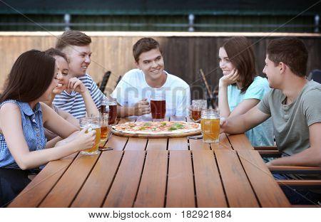 Happy friends in pizzeria