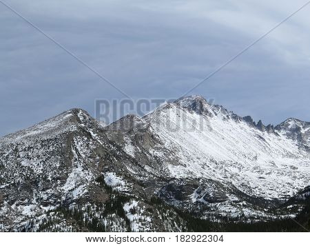 The summit of Longs Peak can be seen from a trail in Rocky Mountain National Park outside of Estes Park Colorado