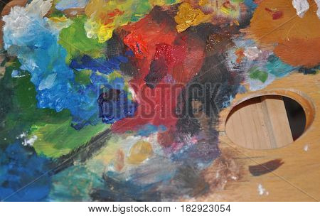 Detail of painters palette abstract mixing colors photo