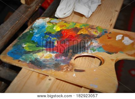 Painters palette with mixed oil paint colors