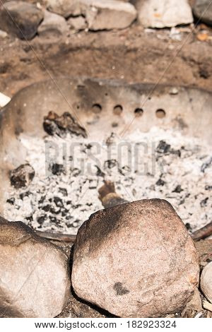 campsite fire pit with natural lake stones and fire basin.