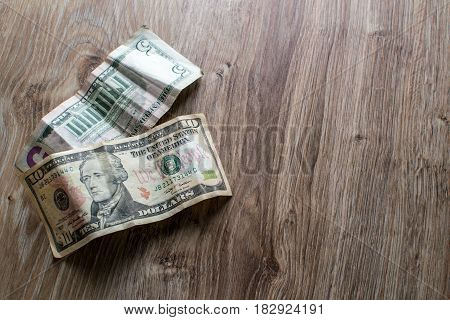 On Wooden Table Are The Dollar