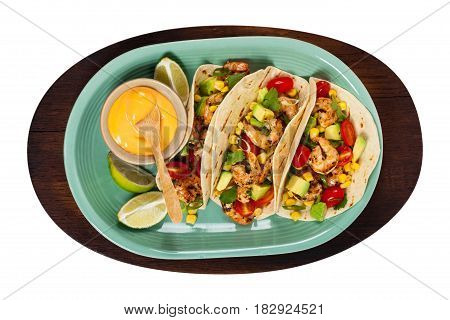 Shrimp Tacos with Corn and Avocado Salsa Isolated on White background. Selective focus.