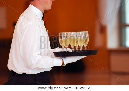 Waiter With Dish Of Vine Glasses