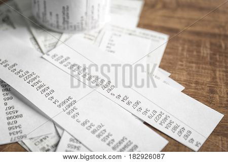 Checks with numbers on wooden table, closeup. Tax concept