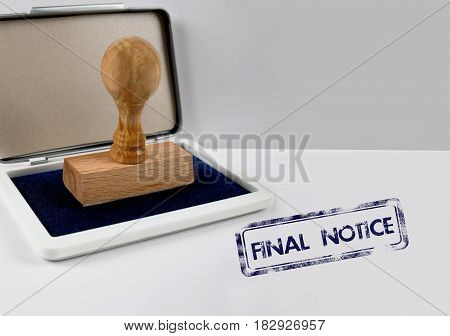 Wooden stamp on a desk FINAL NOTICE