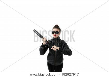 Portrait of an angry woman with a bat, isolated on white background. Serious and strict debt collector