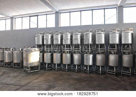 Metal barrels for saving quality brandy on brandy cellar