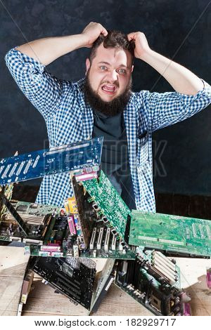 Repairman builds house of cards from motherboards