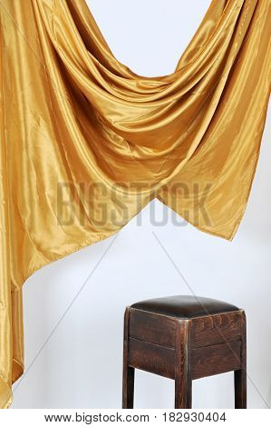 Scene in modern studio with chair and satin curtains on white background