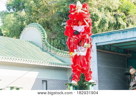 GUNAGDONG CHINA - Nov 27 2015: Lion Dance at Wong Fei Hung Lion Dance Martial Arts Museum. a famous historic site in Foshan Guangdong China.