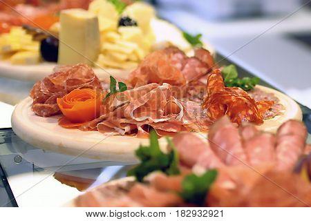 Food tray with delicious salami pieces of sliced ham sausage