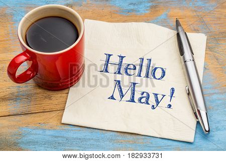 Hello May - cheerful handwriting on a napkin with a cup of coffee