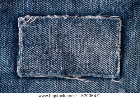 Patch on blue jeans. Jeans background. Denim patch.