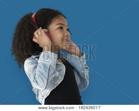 Little Girl Listening To Music Headphones