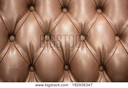 horizontal image of a padded upholstery background with buttons.