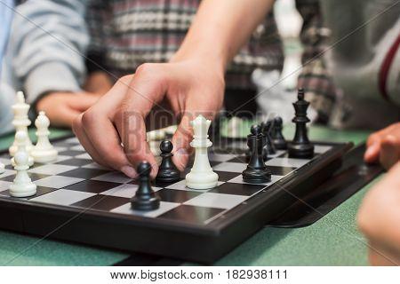 Closeup of children's hand playing chess Chengdu China