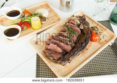 grilled tomahawk beef steak on the bone with seasonings