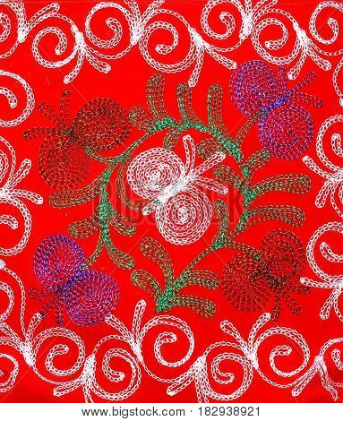 White green and purple patterns on textiles of red color